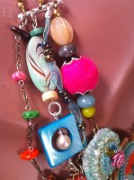 close up of felted and mix media jewellery components