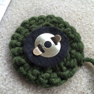 Securing magnetic button to backing felt and crochet circle