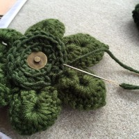 Sew on prepared magnetic button to back of flower